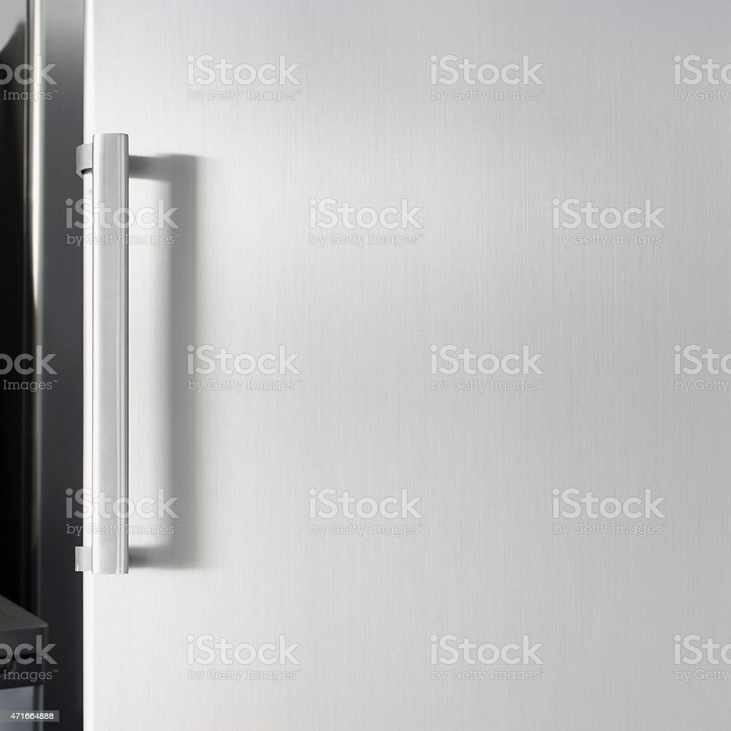 Silver fridge door with handle, with free space for text stock photo