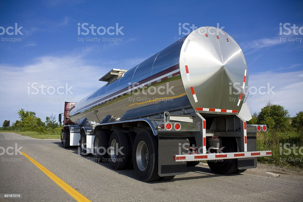 Silver fuel tanker parked on the road stock photo