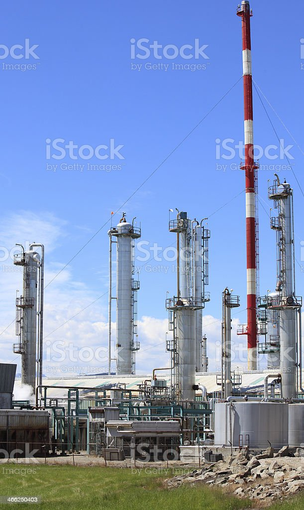 Silver Gas Plant Towers With Red And White Stack royalty-free stock photo