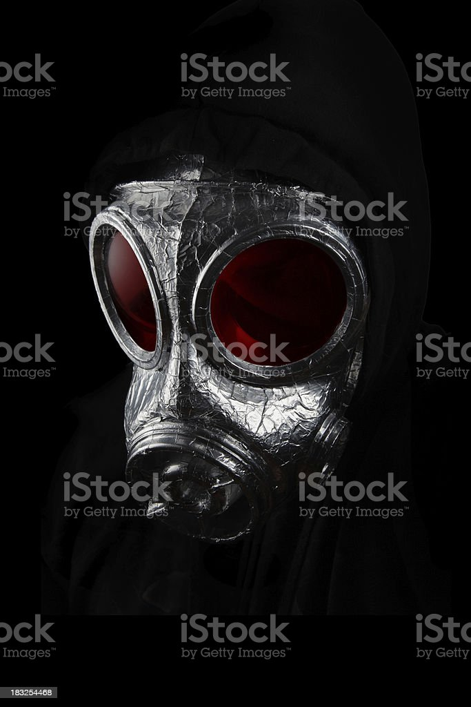 silver gasmask with red tinted lens in moody shot royalty-free stock photo