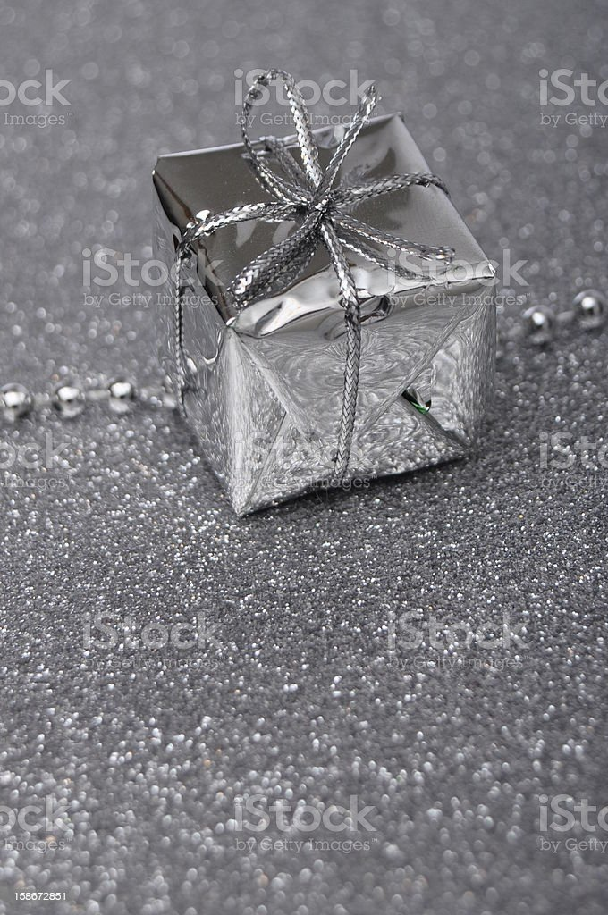 Silver gift box on gray brilliant background royalty-free stock photo