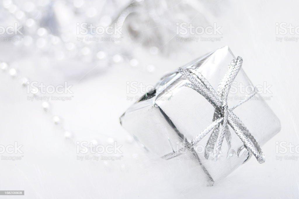 Silver gift box on white blur background royalty-free stock photo