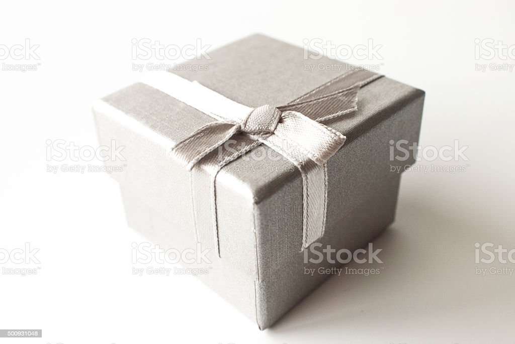 silver gift box with silver ribbon stock photo