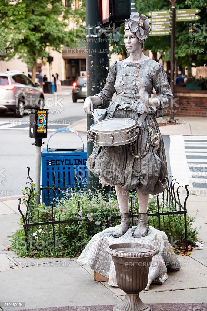 Silver Girl With Her Drum stock photo