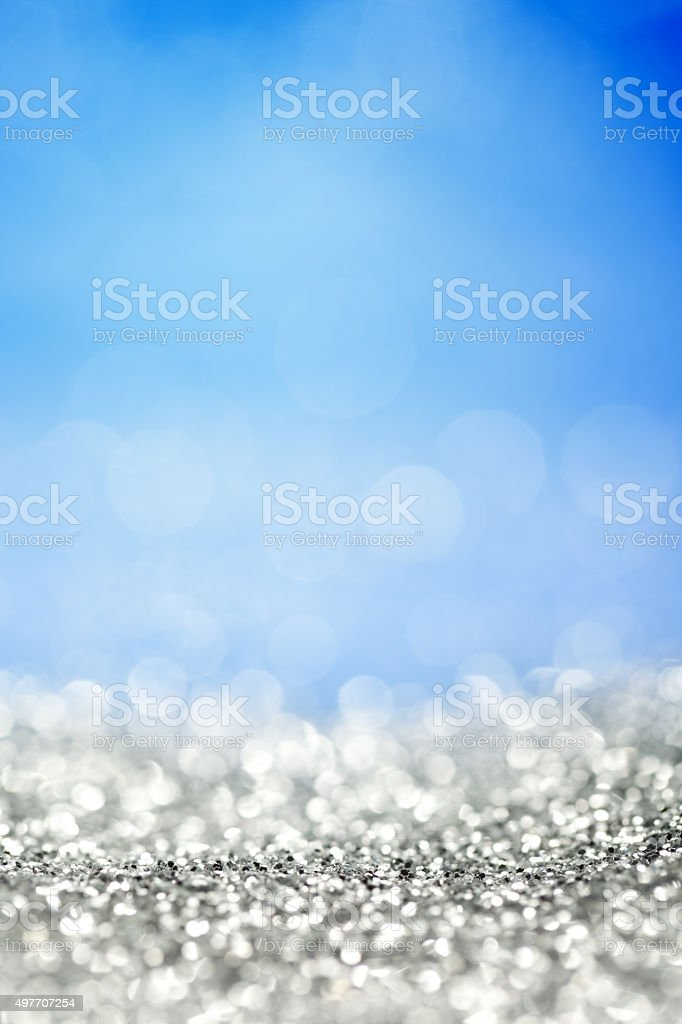 Silver glitter and blue background stock photo