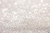 Silver glitter bokeh background