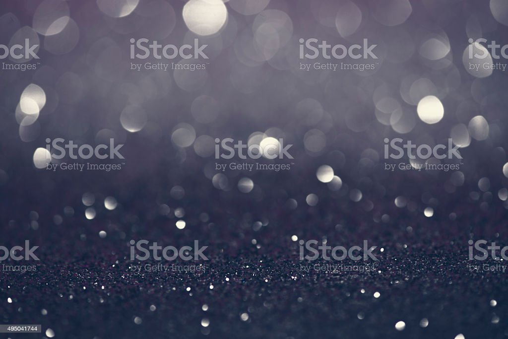 Silver glittering christmas lights. Blurred abstract background stock photo