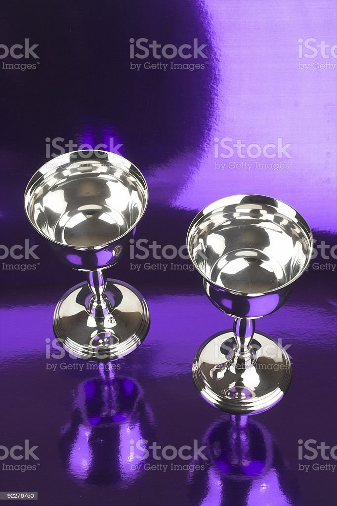Silver Goblets On Reflective Purple background royalty-free stock photo