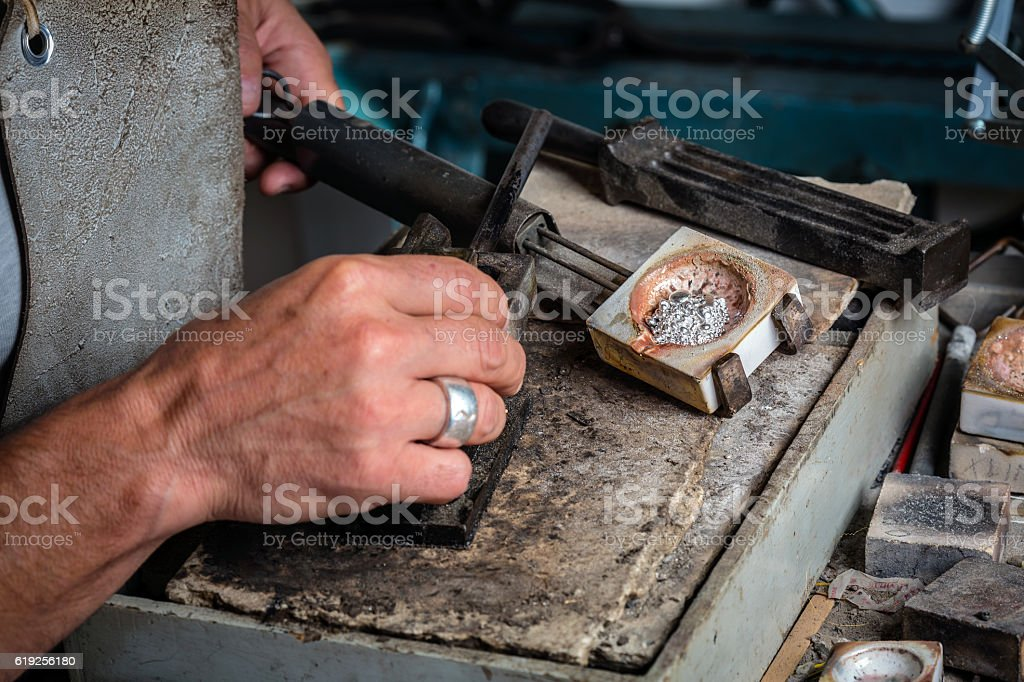 Silver Grains in Crucible at Goldsmith Workshop stock photo