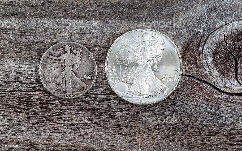 Silver Half dollar and Dollar coins stock photo