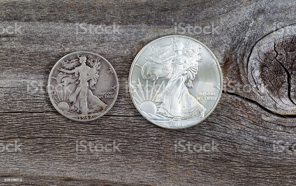 Silver Half dollar and Dollar coins stock photo