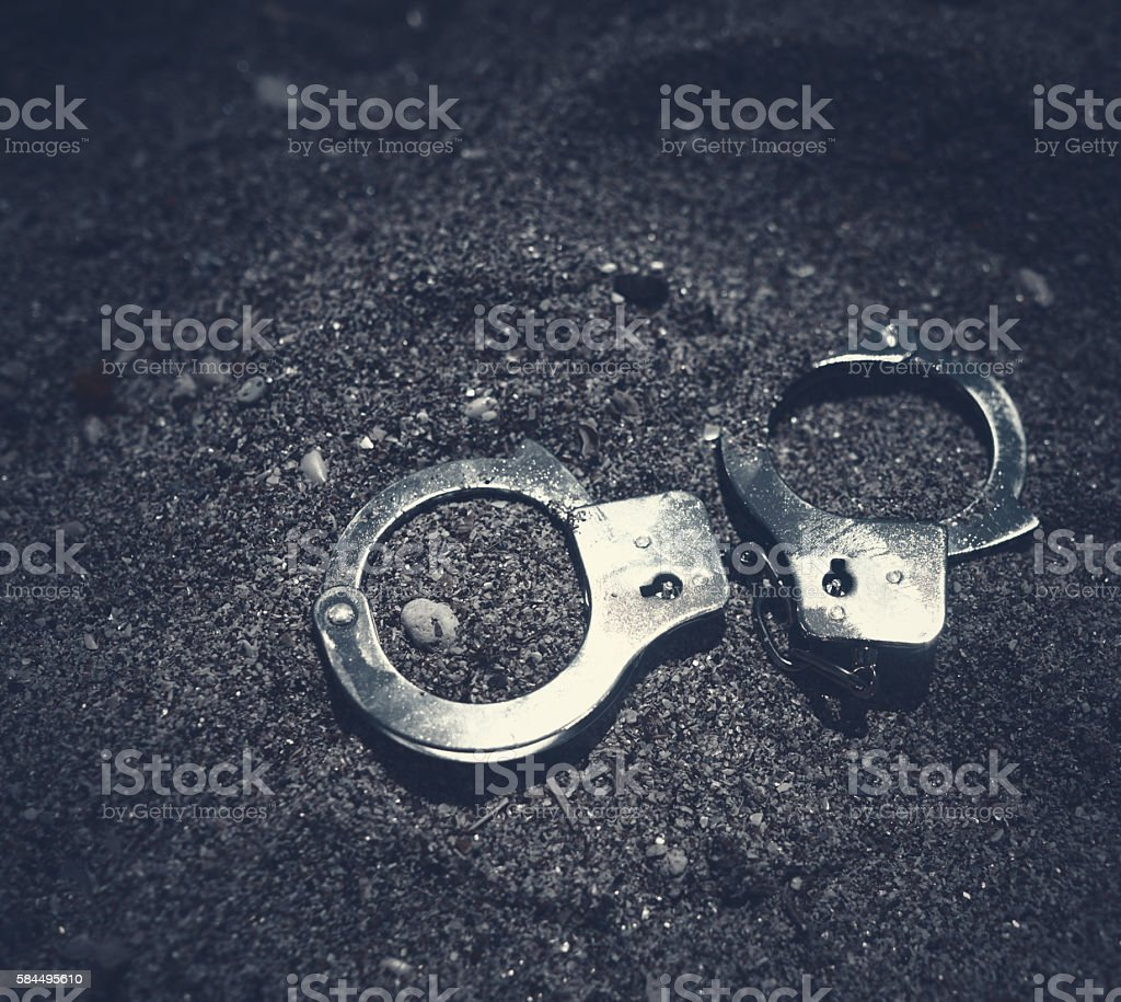silver handcuffs stock photo