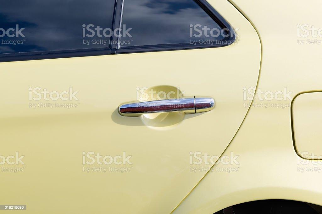 Silver handle on the door of retro car stock photo