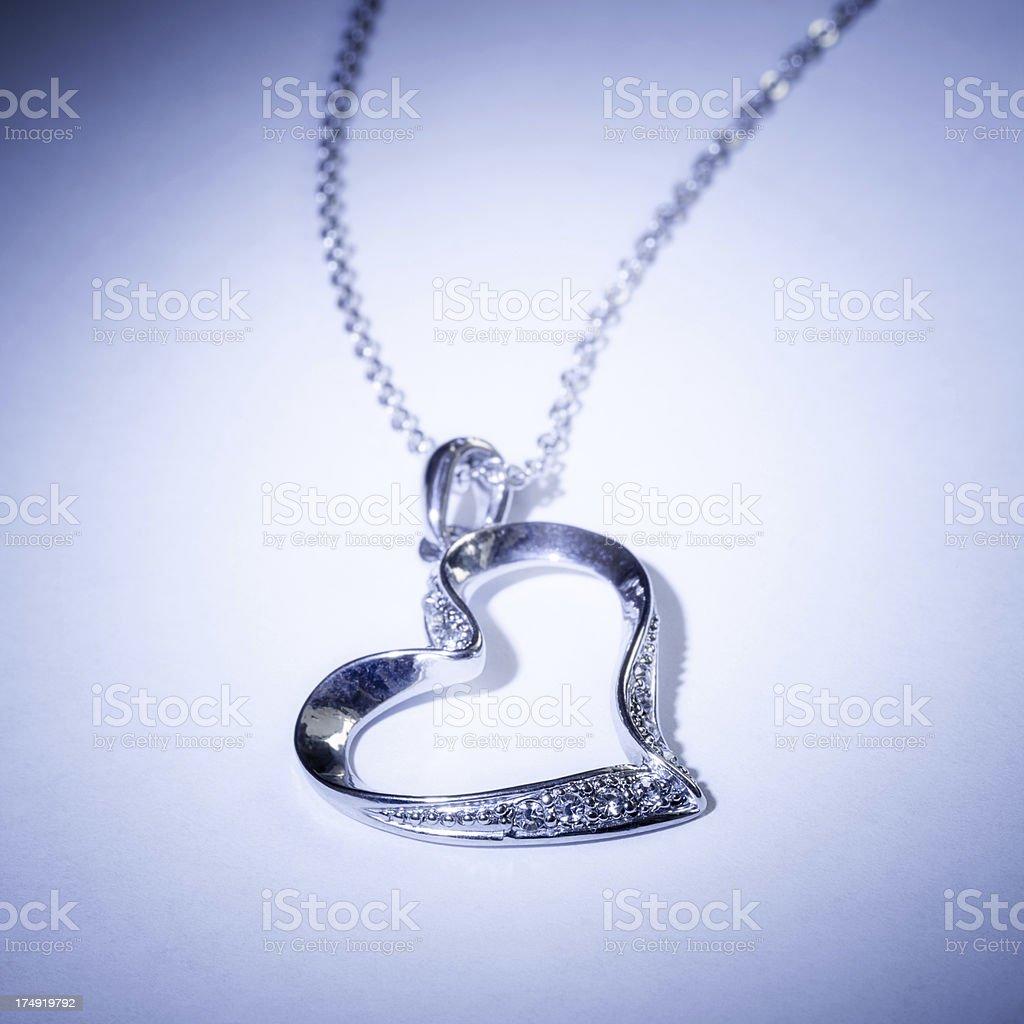 Silver heart pendant royalty-free stock photo