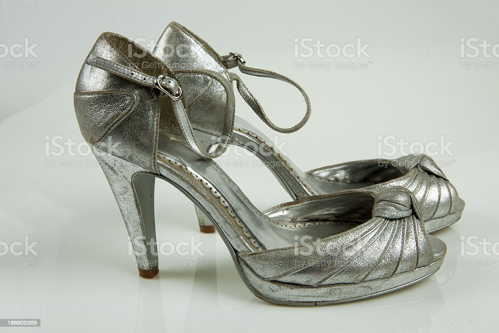 Silver high-heeled shoes royalty-free stock photo