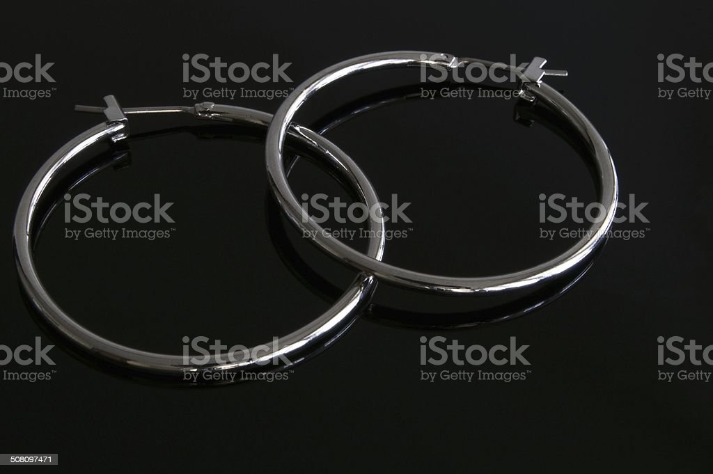 Silver hoop earrings stock photo
