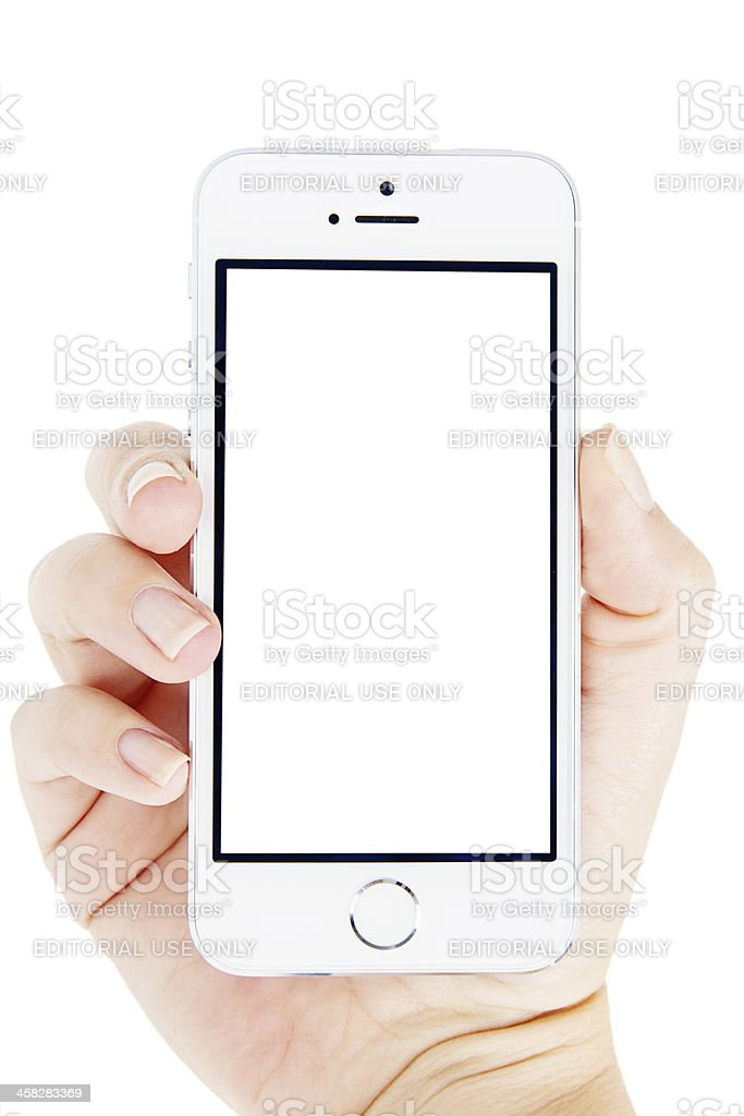 Silver iPhone 5s with Hand royalty-free stock photo