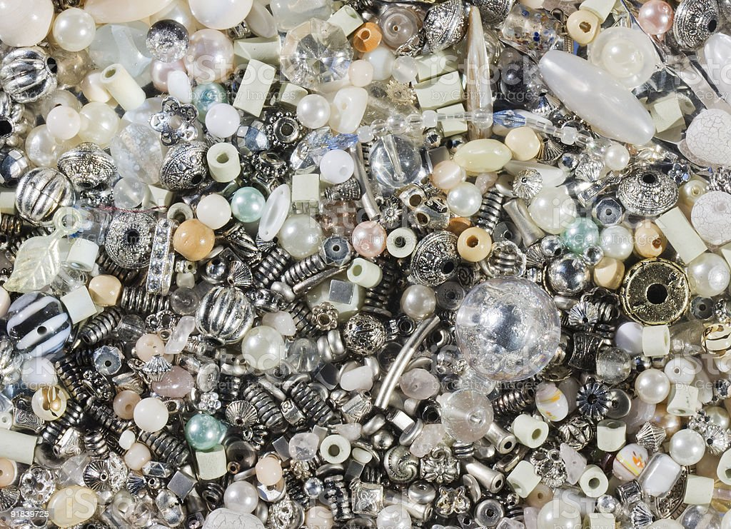 Silver, iron and glass beads stock photo