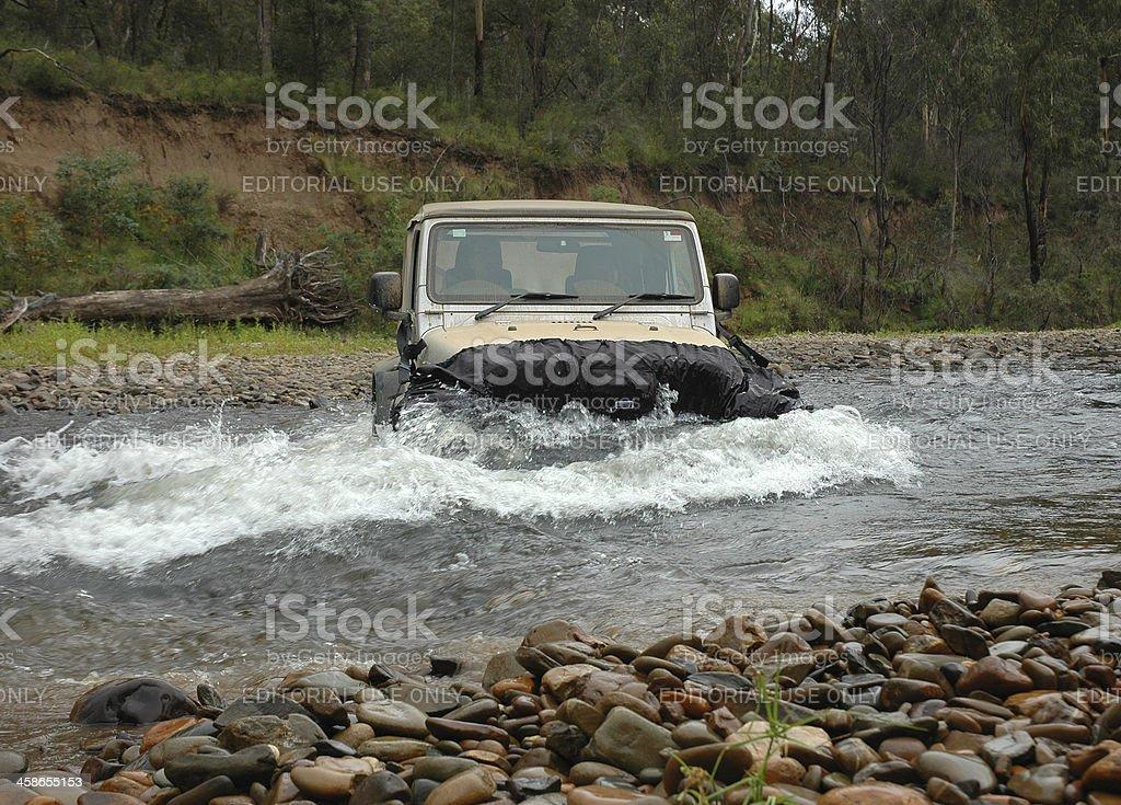 Silver Jeep TJ Wrangler river crossing stock photo