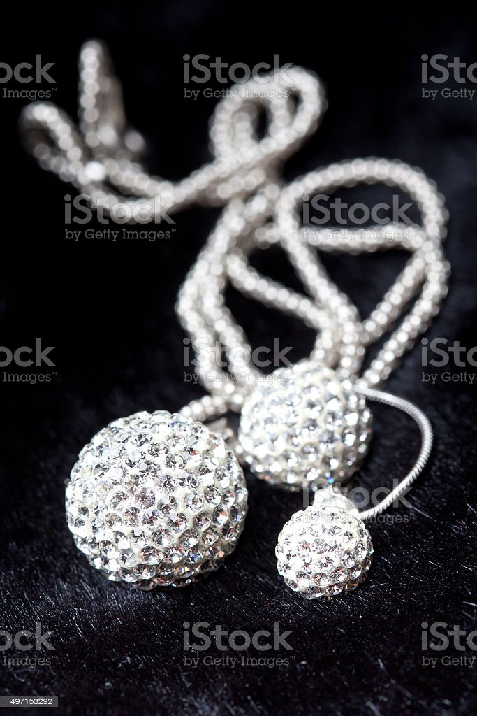 Silver jewlery on black background stock photo