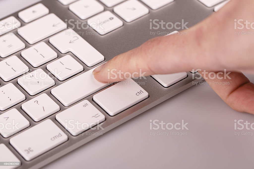 silver keyboard with woman finger royalty-free stock photo