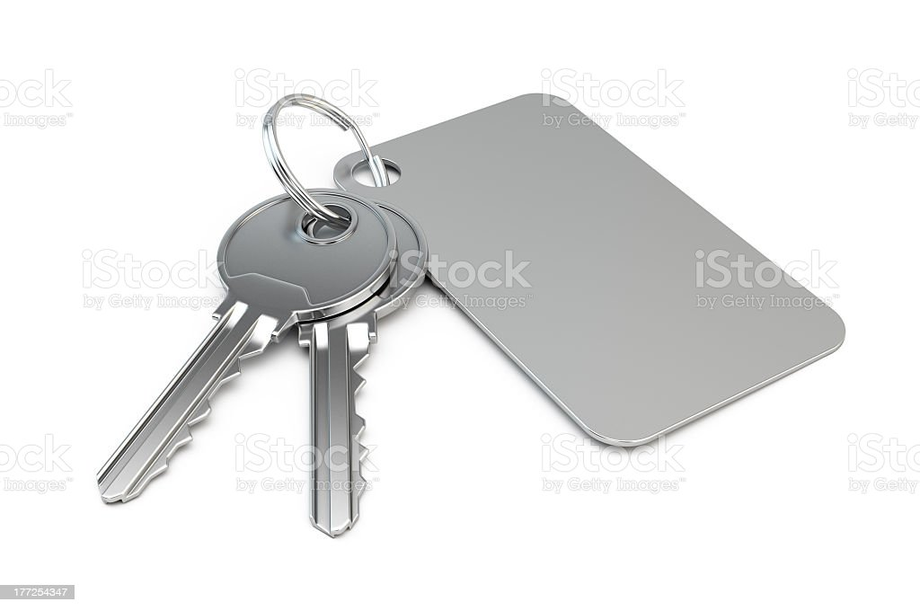 Silver keys with silver blank label on white background stock photo