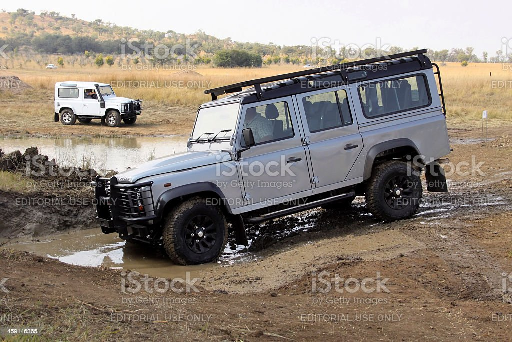 Silver Land Rover Defender 110 SW on 4x4 Course stock photo
