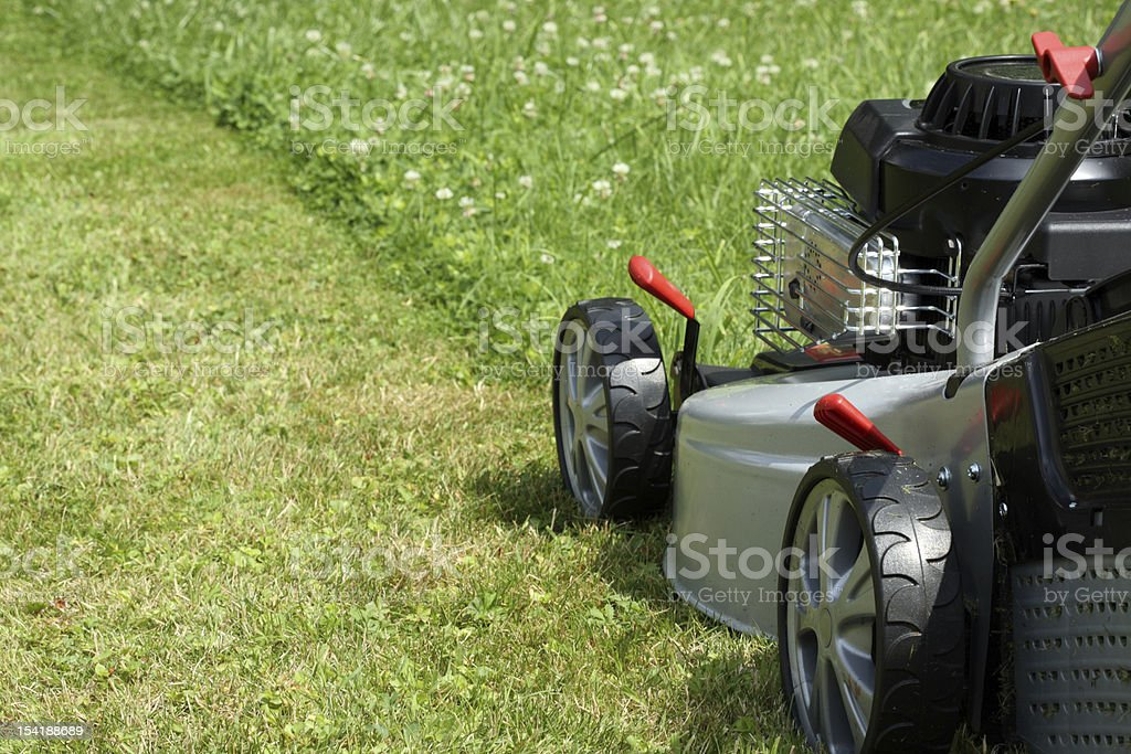 Silver lawn mower. stock photo