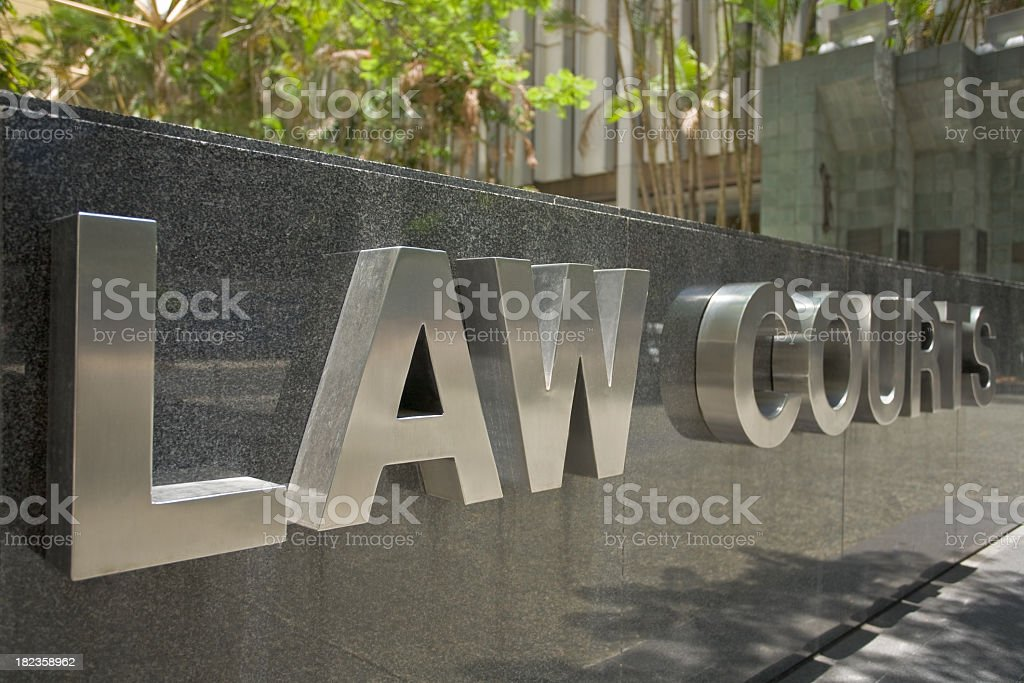 3D silver letters saying law courts on a stone sign royalty-free stock photo