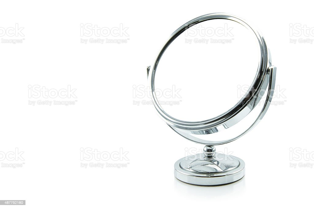 silver makeup mirror isolated on white. stock photo