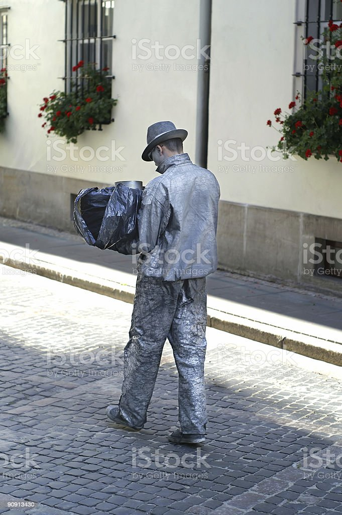 Silver man walking royalty-free stock photo