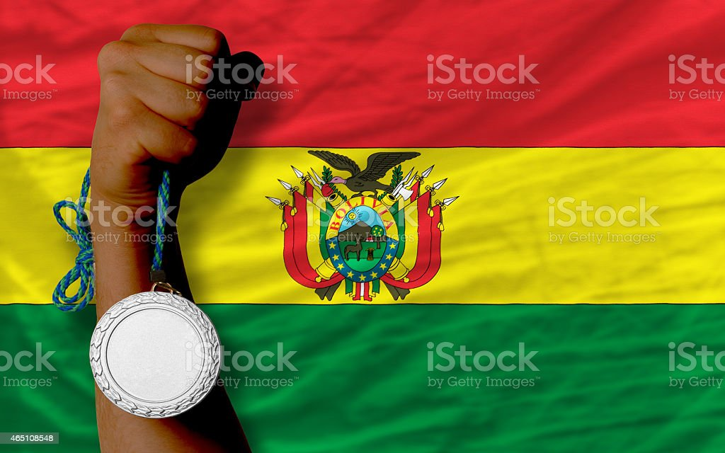 Silver medal for sport and flag of bolivia stock photo