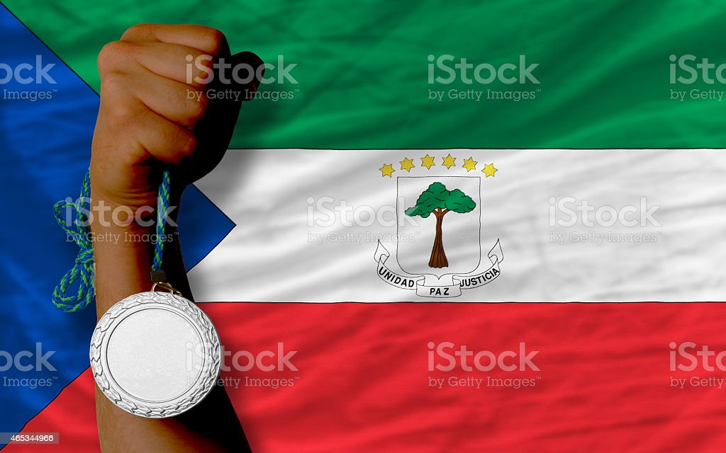 Silver medal for sport and flag of equatorial guinea stock photo