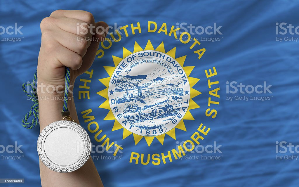 Silver medal for sport and flag of south dakota royalty-free stock photo