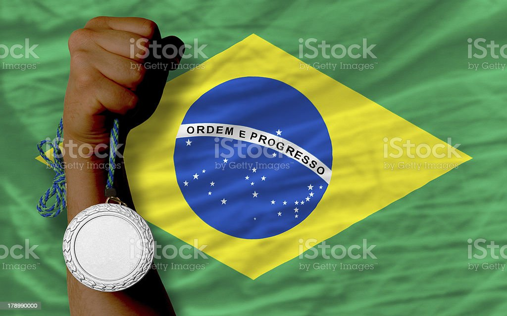 Silver medal for sport and  national flag of brazil royalty-free stock photo