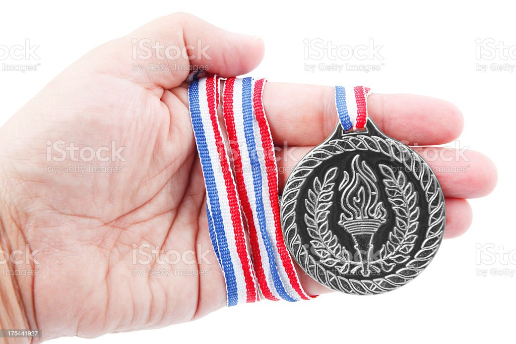 Silver medal in hand royalty-free stock photo