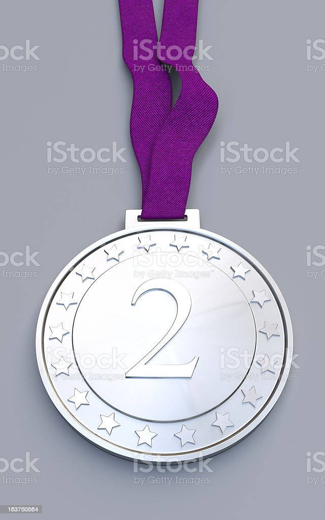 Silver medal with number on a purple ribbon royalty-free stock photo