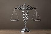 Silver Medical Caduceus Symbol as Scales. 3d Rendering