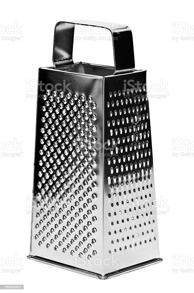 Silver metal cheese grater with multiple grating options stock photo