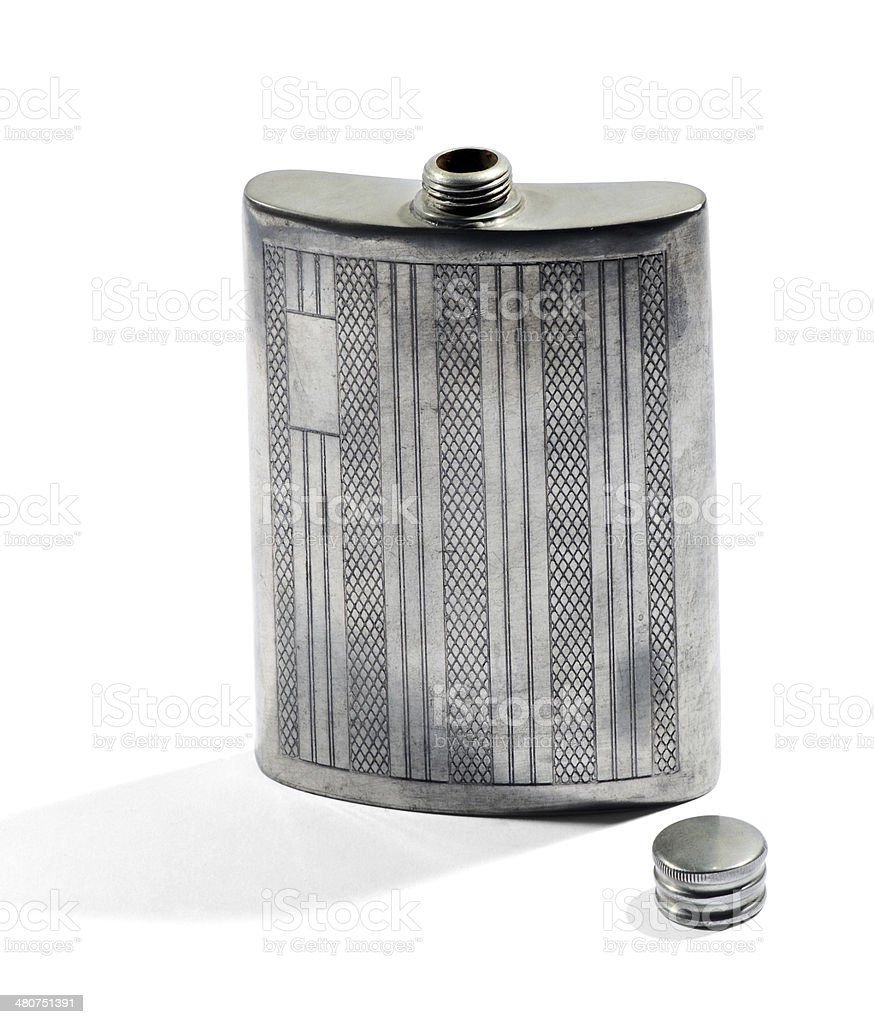 Silver metal hip flask for carrying whiskey stock photo