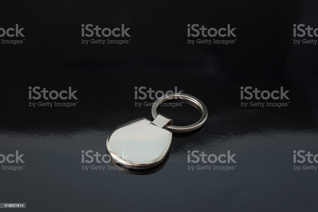 silver metal keychain on black background stock photo