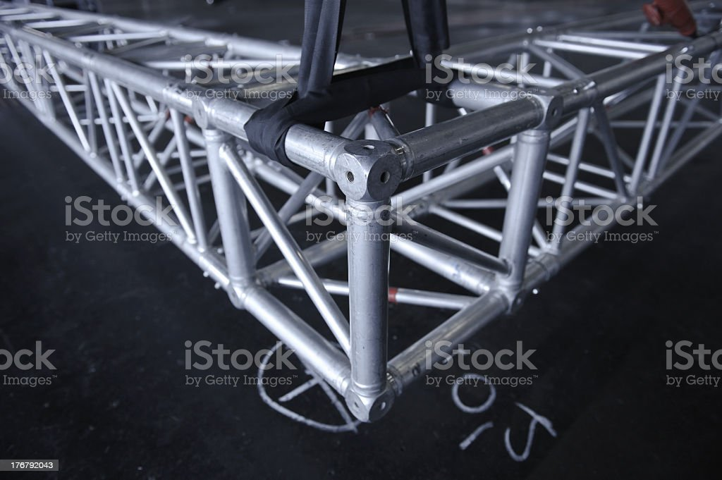 Silver metal rigging truss on a black floor stock photo