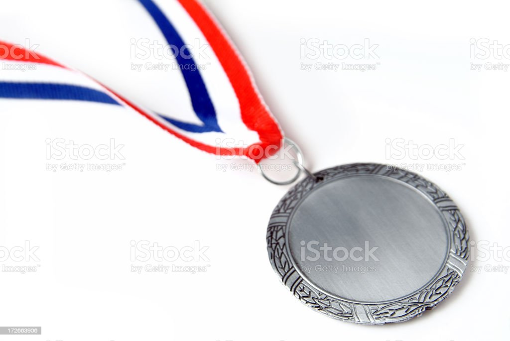 Silver Metal with Red, White and Blue Strap on White Background stock photo