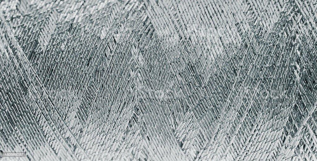 silver metallic threads stock photo