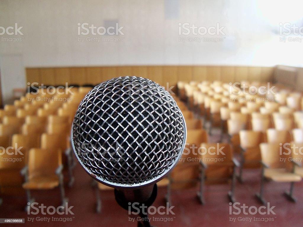 Silver microfone in auditorium stock photo