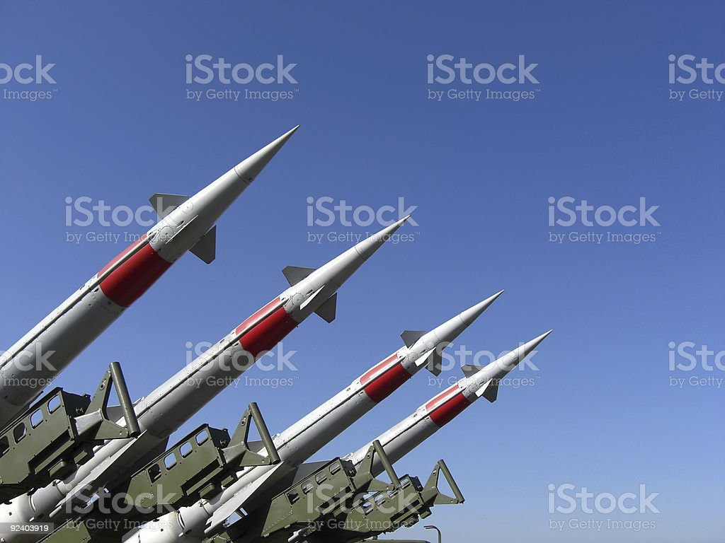 Silver Missiles In The Blue Sky stock photo