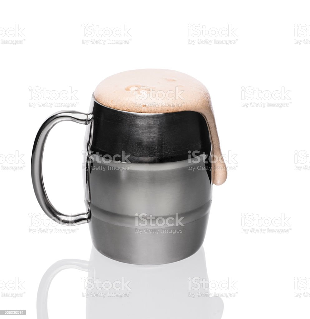 Silver mug of home made dark beer. stock photo