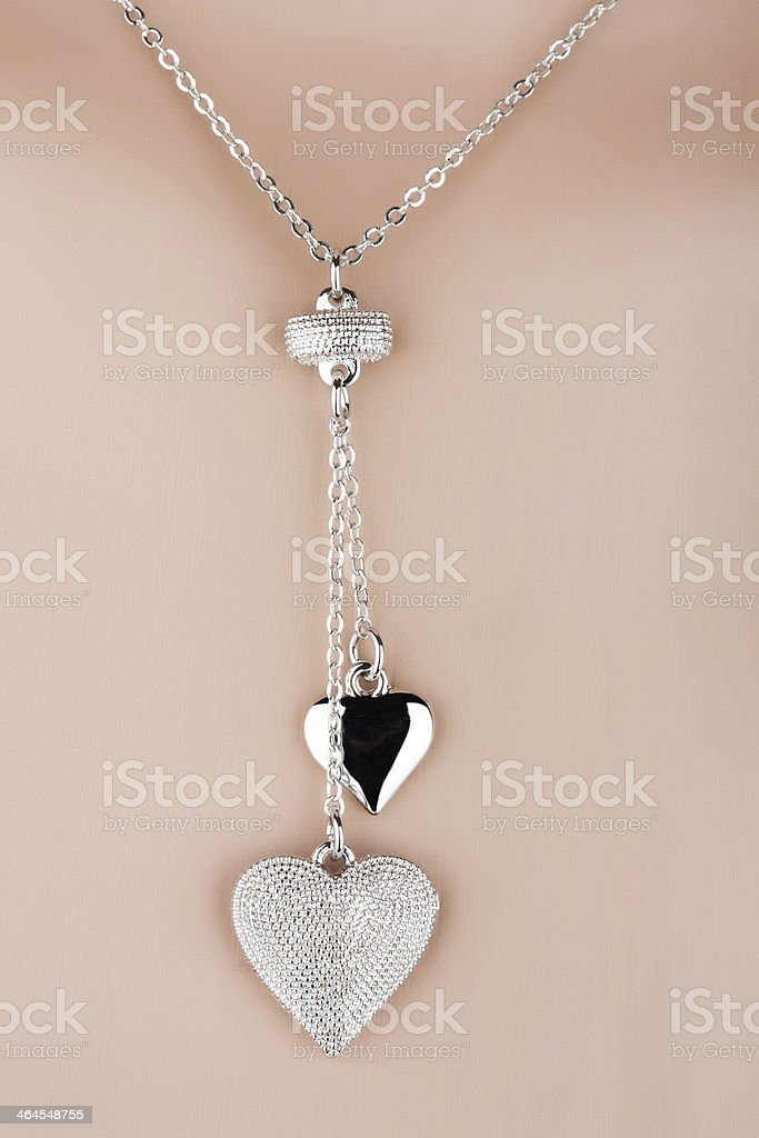 Silver necklace with two heart pendants stock photo