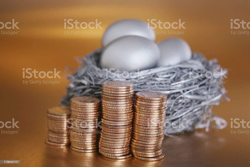 Silver Nest Egg with Gold Coins royalty-free stock photo