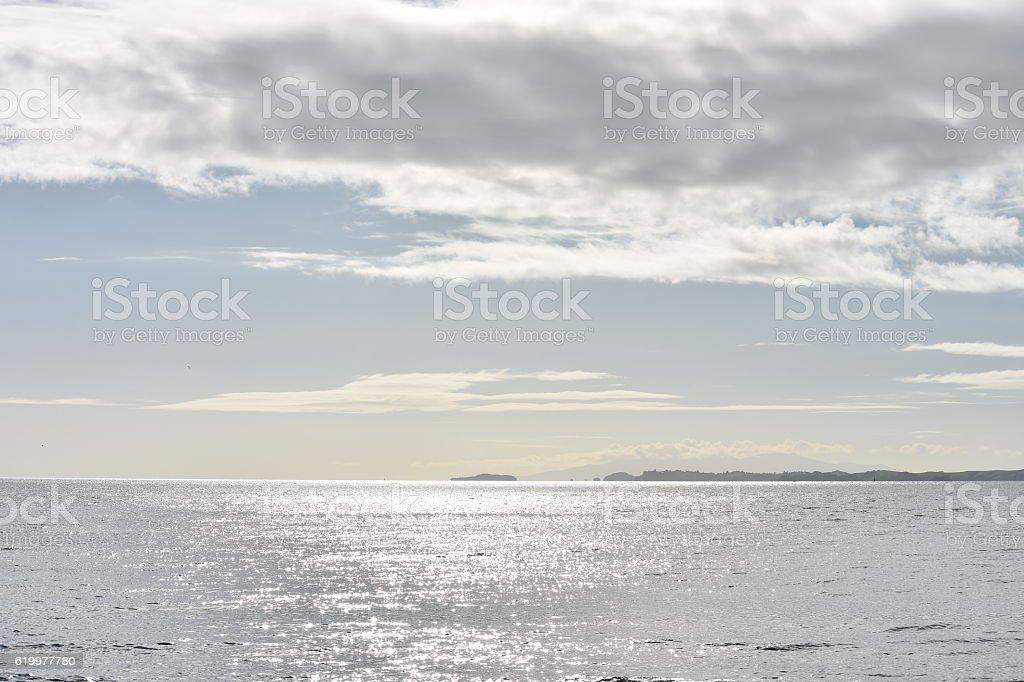 Silver ocean cloudy sky stock photo